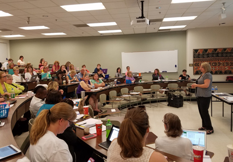 Family members and educators attend a workshop during Summer Institute.